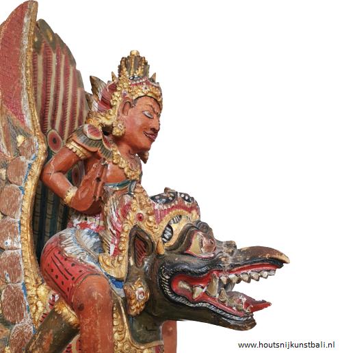 Garuda and Vishnu, Bali wood carving, Indonesia. Vishnu and Garuda wearing gold jewelry. The wood carving is painted. Circa 1900 - 1930