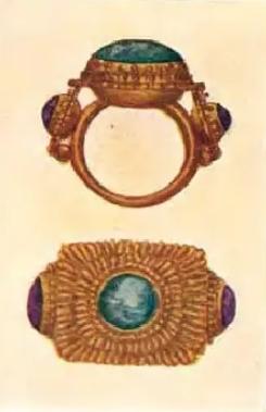 ali-ali sekar tandjoeng: gouden Balinese ring met 3 edelstenen.